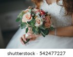 bridal bouquet in hands of the... | Shutterstock . vector #542477227