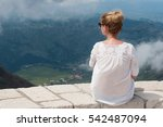 girl sitting on the mount... | Shutterstock . vector #542487094