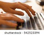 hands working on the computer... | Shutterstock . vector #542523394