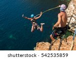 rope jumping off a cliff with a ... | Shutterstock . vector #542535859