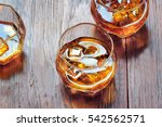 glass with whiskey on table... | Shutterstock . vector #542562571