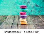 colorful macarons on vintage... | Shutterstock . vector #542567404