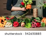florist with bouquet of roses... | Shutterstock . vector #542650885