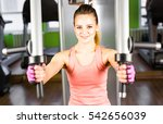 young woman weight training | Shutterstock . vector #542656039
