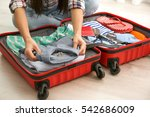 woman putting clothes in... | Shutterstock . vector #542686009