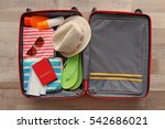 open suitcase packed for... | Shutterstock . vector #542686021