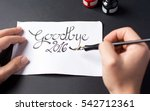 calligraphy writting a goodbye... | Shutterstock . vector #542712361