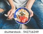 eating healthy breakfast bowl.... | Shutterstock . vector #542716249
