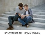 two guys sitting on stairs with ... | Shutterstock . vector #542740687