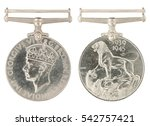 1939-1945 General Service Medal inscription GEORGIVS VI D G BR OMN REX ET INDIAE IMP no ribbon isolated on white with clippimg path - stock photo
