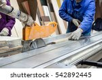 worker using saw machine to... | Shutterstock . vector #542892445