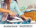 closeup of woman ironing... | Shutterstock . vector #542959927
