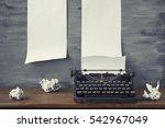Old Black Typewriter With Pape...