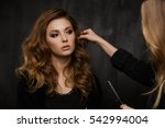 stylist corrects hair of girl | Shutterstock . vector #542994004