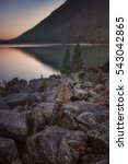 sunset mountain lake with rocks ... | Shutterstock . vector #543042865