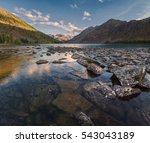 rocky lake surrounded with... | Shutterstock . vector #543043189
