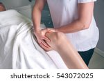 Small photo of Massage therapist hands doing lymphatic drainage treatment to woman