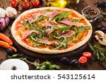 pizza with bacon and arugula on ... | Shutterstock . vector #543125614