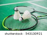 Shuttlecock On Badminton Racket.