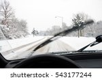 Drive on snowy road; Sudden onset of winter; Difficult driving conditions in winter time - stock photo