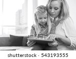 happy woman with daughter using ... | Shutterstock . vector #543193555