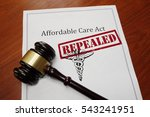 Small photo of Affordable Care Act aka ObamaCare policy with Repealed stamp and gavel