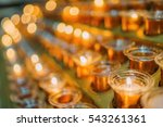 multiple candles in the glass... | Shutterstock . vector #543261361