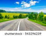 rural paved road among green... | Shutterstock . vector #543296239