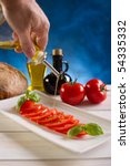 olive oil over tomato salad on ... | Shutterstock . vector #54335332