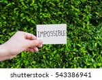 "hand holding ""impossible"" card... 