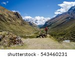 Small photo of Young woman looking at the scenic view during the Salkantay trek
