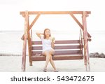 woman relaxing at the seaside. | Shutterstock . vector #543472675
