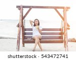 woman relaxing at the seaside. | Shutterstock . vector #543472741