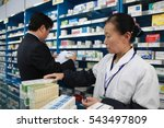 Small photo of Jiangxi, China - April 17 2012:iangxi, Jiujiang food and drug administration staff in pharmacies to check suspected chromium exceeded medicinal hollow capsule products.