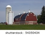 Red Barn With Silos And Tracto...