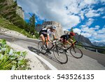 Small photo of two biker by race cycling contest