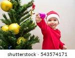 Baby Girl With Christmas Ball