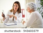 doctor and patient discussing... | Shutterstock . vector #543603379