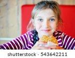 cute little girl eating a... | Shutterstock . vector #543642211