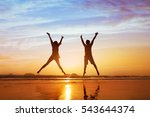 happy couple jumping on the... | Shutterstock . vector #543644374