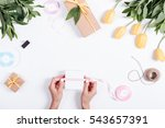 female hand tied ribbon box... | Shutterstock . vector #543657391