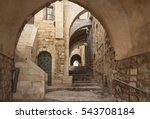 Old city hidden passageway, stone stairway and arch. Jerusalem, Israel