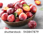 Fresh Plums On A Grey Wooden...