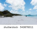 a couple walking on whitehaven... | Shutterstock . vector #543878311