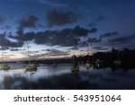 boats sitting in the lake at... | Shutterstock . vector #543951064