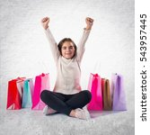kid with many shopping bags  on ... | Shutterstock . vector #543957445