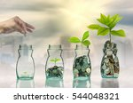 hand putting mix coins and seed ... | Shutterstock . vector #544048321