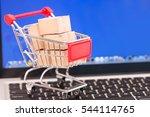 shopping cart with cardboard... | Shutterstock . vector #544114765