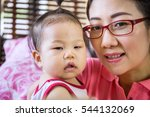 mother with her baby daugther... | Shutterstock . vector #544132069