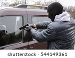 male thief with pistol trying...